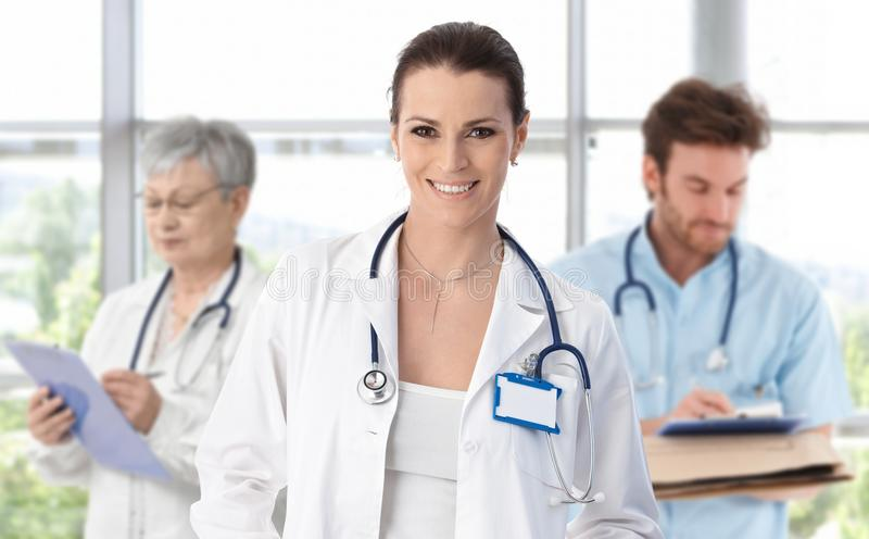 Medical team female doctor in front royalty free stock image