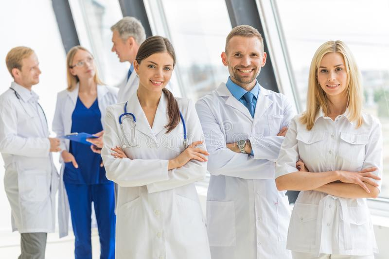 Medical team group portrait. In hospital, people standing with arms crossed royalty free stock photos