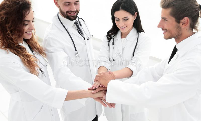 Medical team with hands clasped together. Happy medical team with hands clasped together.the concept of teamwork royalty free stock images