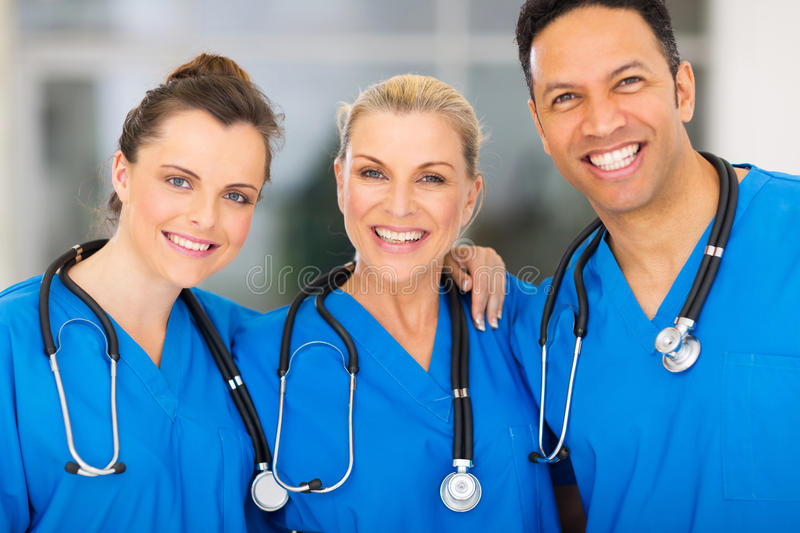 Medical team hospital. Group of happy medical team in hospital royalty free stock photo