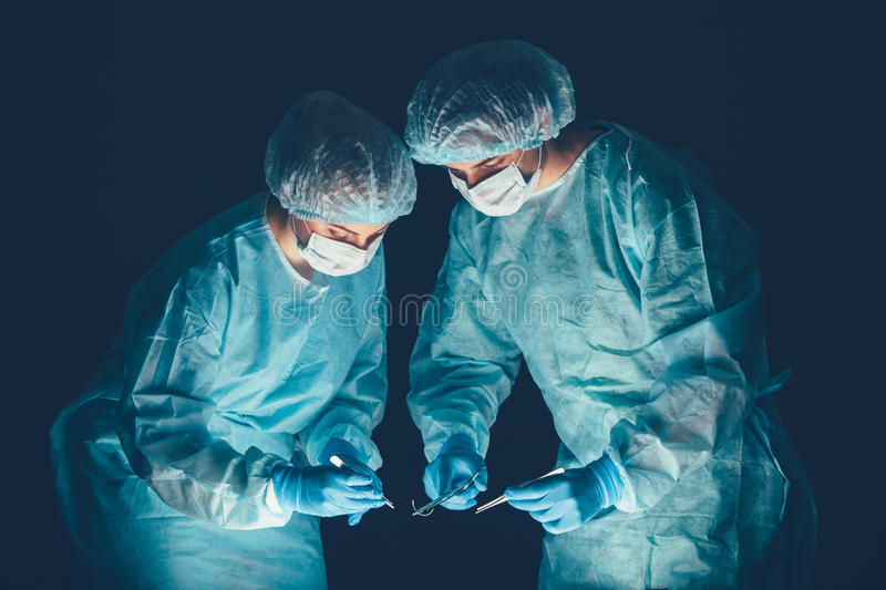 Medical team hospital performing operation. Group of surgeon at work in operating theatre room. healthcare . Medical team in hospital performing operation royalty free stock image