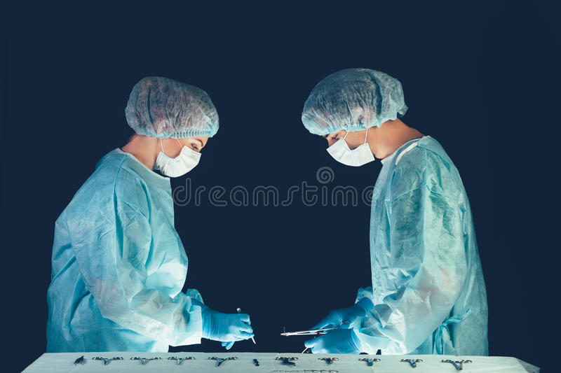 Medical team hospital performing operation. Group of surgeon at work in operating theatre room. healthcare . Medical team in hospital performing operation royalty free stock images
