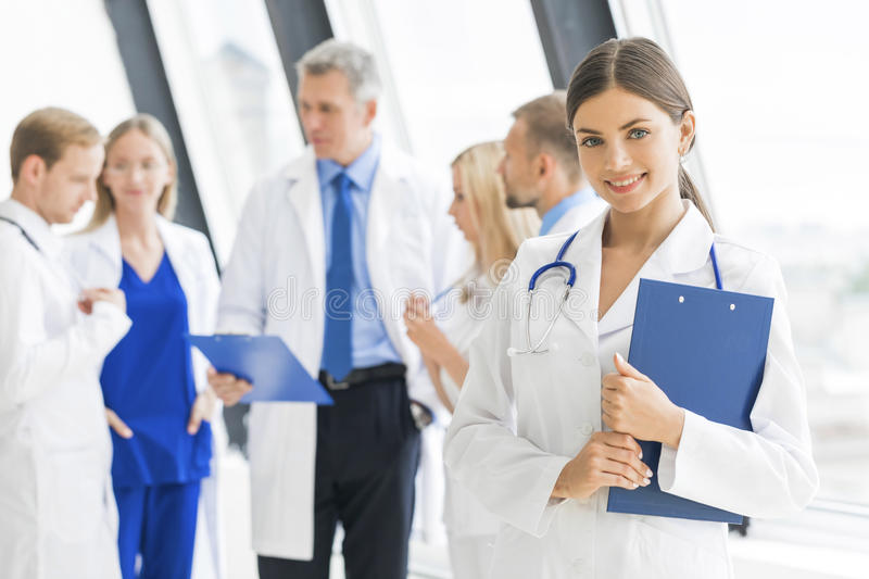 Medical team in hospital. Young female doctor and medical team in hospital stock photography