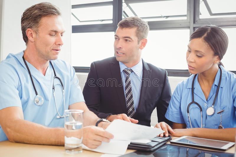 Medical team interacting in conference room. Medical team interacting at a meeting in conference room stock photography