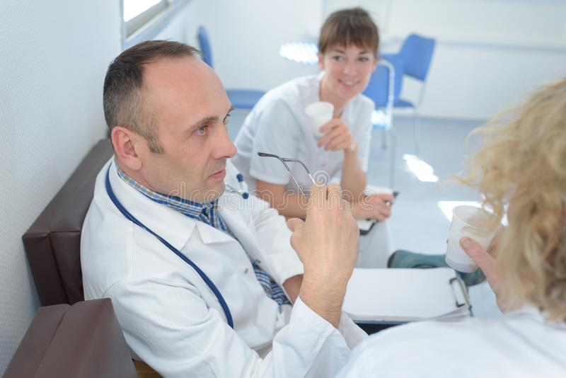 Medical team interacting during meeting at hospital. Medical team interacting during meeting at the hospital royalty free stock images
