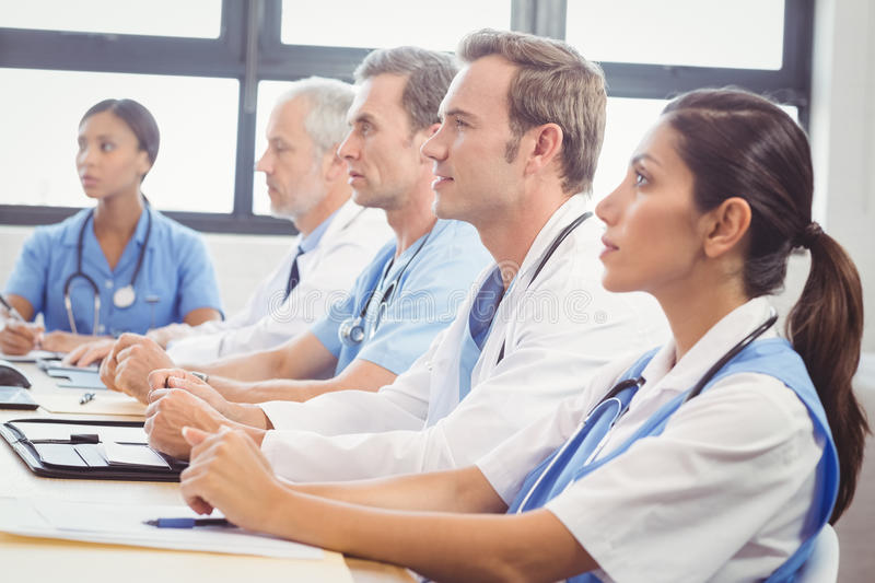 Medical team listening in conference room. In hospital royalty free stock photography