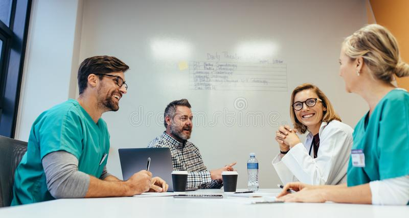 Medical team meeting in conference room stock photography