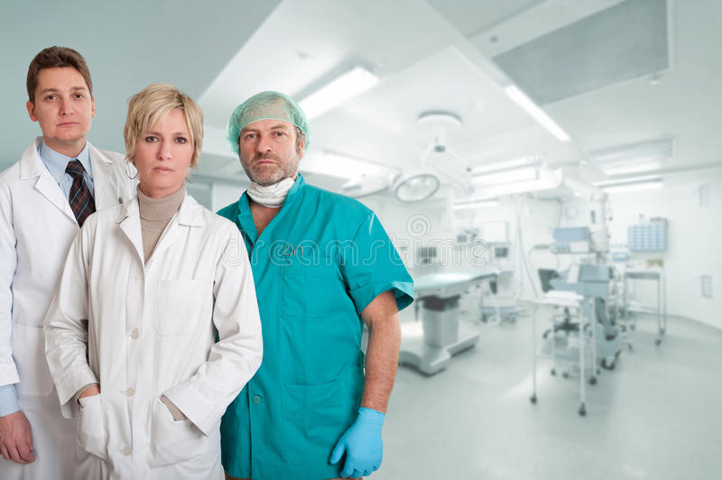 Medical team at operating room. Medical team, with surgeon, anesthetist and nurse in an operating room stock photography