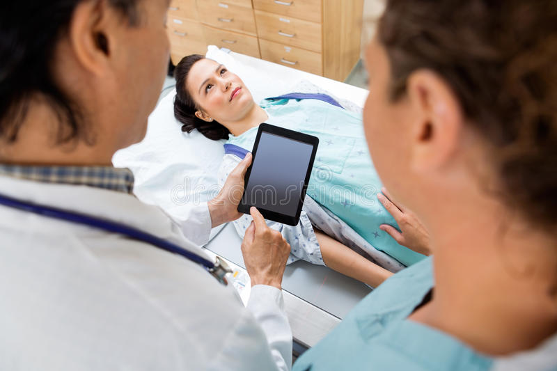 Medical Team With Patient In Hospital Room royalty free stock photos