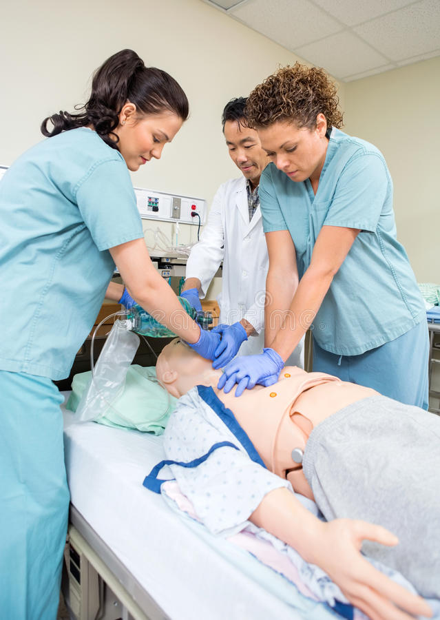 Medical Team Performing CPR On Dummy royalty free stock image