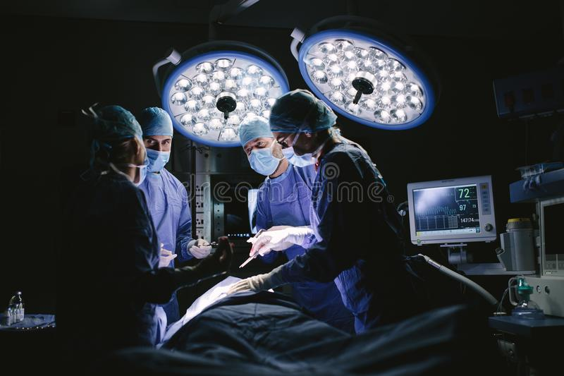 Medical team performing surgery in hospital royalty free stock images