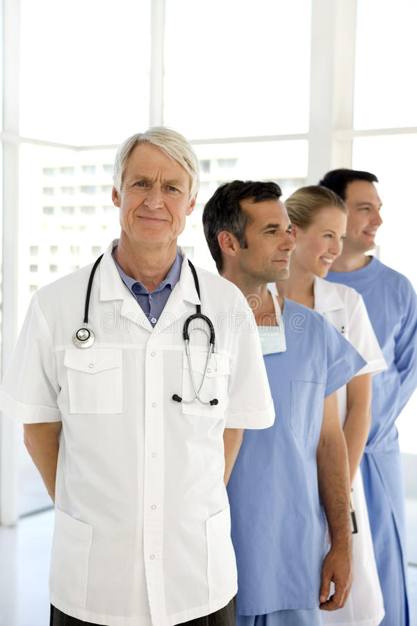 Medical team. Portrait of a medical team with senior leader royalty free stock image