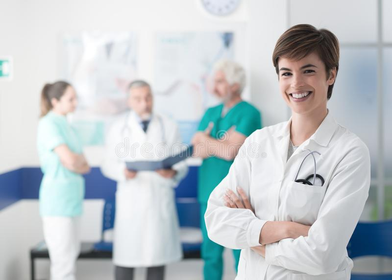 Medical team posing at the hospital and young doctor royalty free stock images