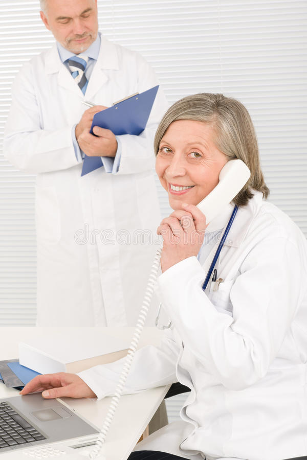 Download Medical Team Senior Female Phone Male Colleague Stock Photo - Image: 23574924