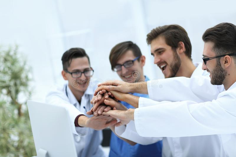 Medical team showing their success. Photo with copy space stock images