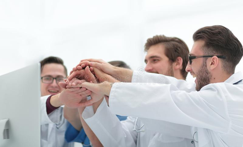 Medical team showing their success. Photo with copy space royalty free stock photography