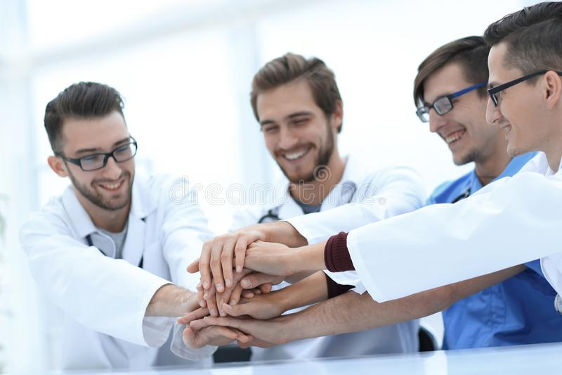 Medical team showing their success. Photo with copy space stock photo