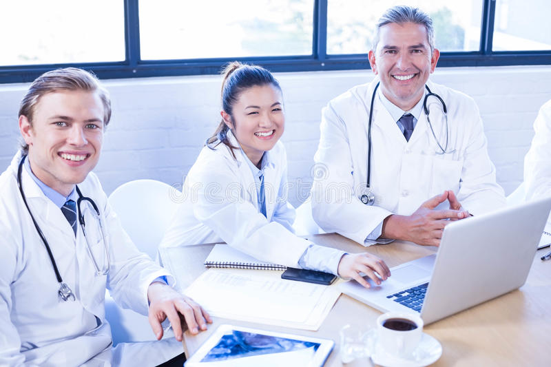 Medical team smiling at conference room. Portrait of medical team smiling at conference room royalty free stock images