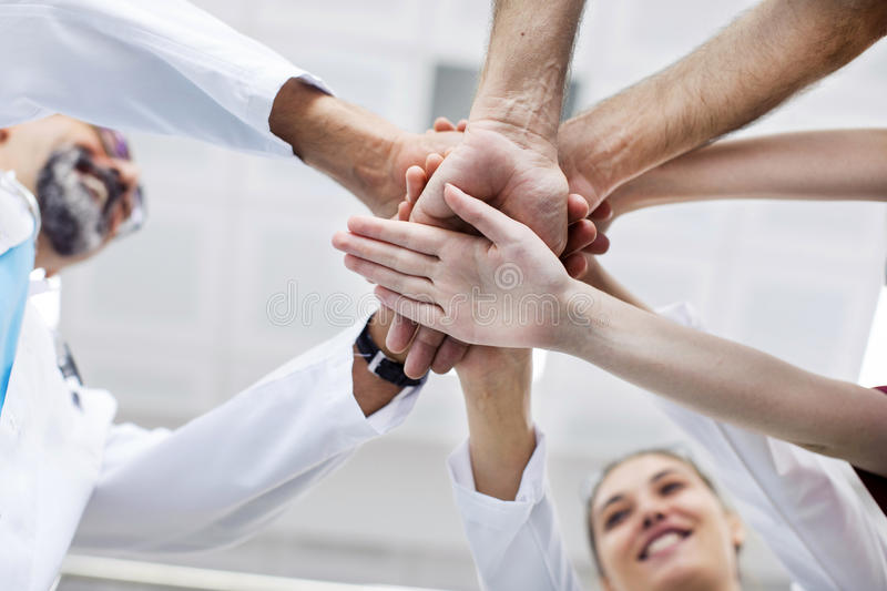 Medical team stacking hands. In the clinic stock photos