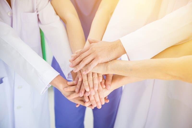 Medical team stacking hands together with vintage filter. Medical teamwork concept royalty free stock photography