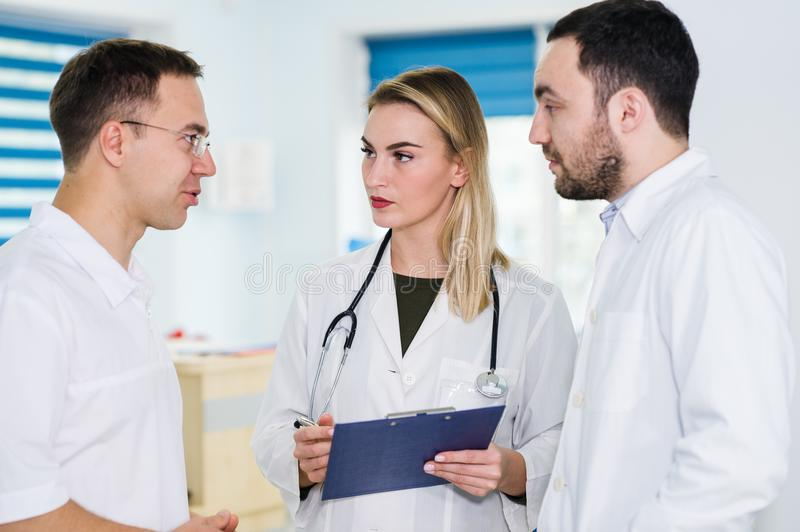 Medical team standing and talking at the hospital stock images