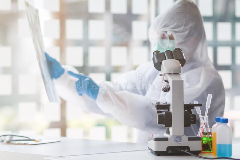 The medical team wore a coronavirus protective suit and rubber gloves to examine the coronavirus covid-19 and research for a. Vaccine to prevent coronavirus royalty free stock photo