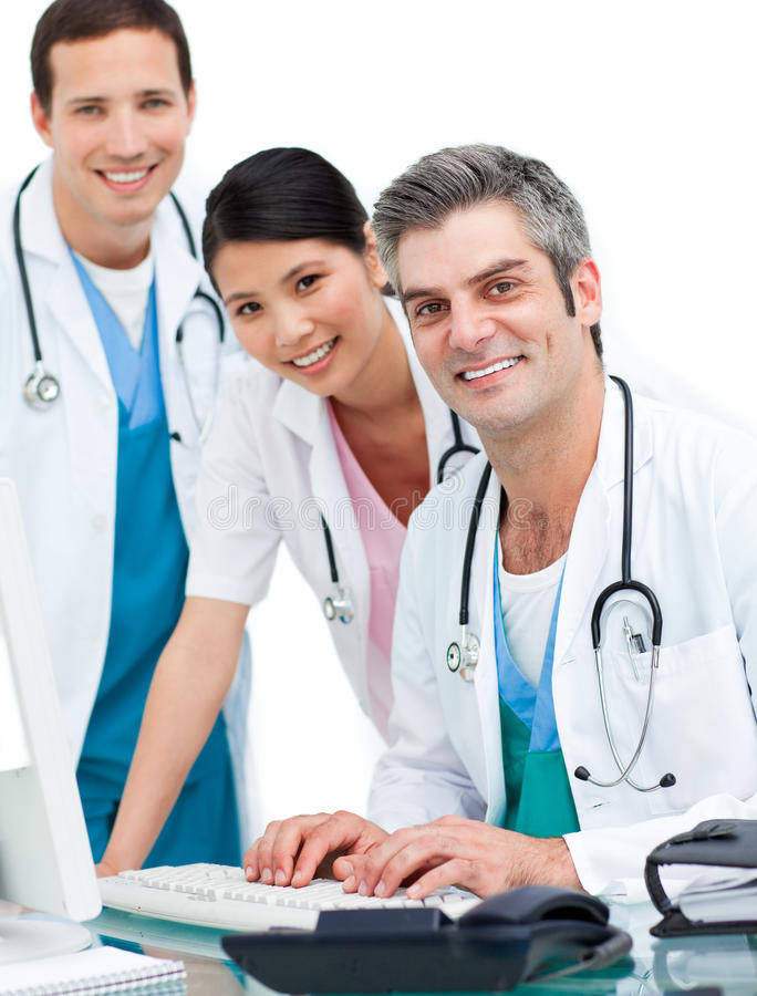 Medical team working at a computer royalty free stock images