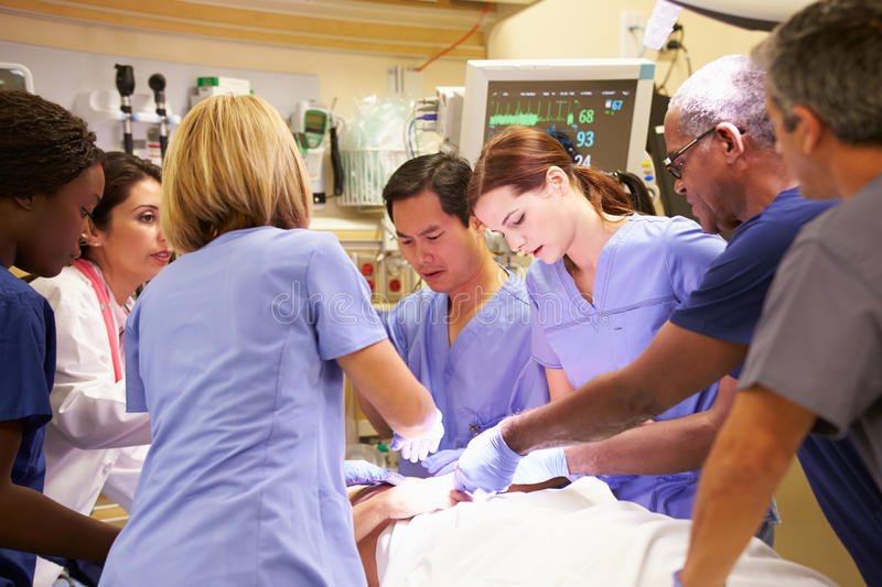 Medical Team Working On Patient In Emergency Room stock photo
