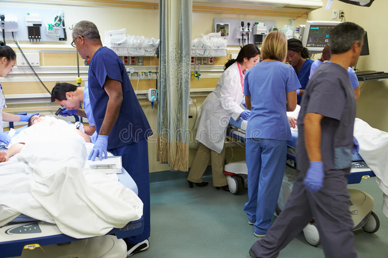 Medical Team Working On Patient In Emergency Room stock image