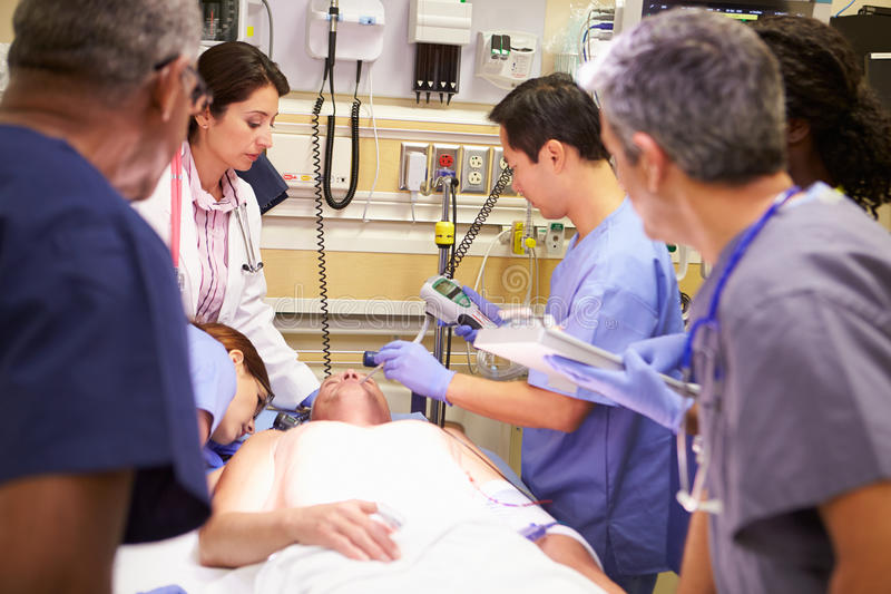 Medical Team Working On Patient In Emergency Room royalty free stock photo