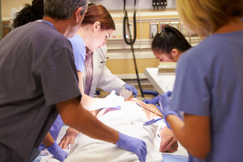 Medical Team Working On Patient In Emergency Room stock photography