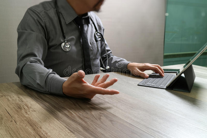 Medical technology concept. Doctor hand working with modern digital tablet dock screen computer with medical chart interface, Sun. Flare effect photo royalty free stock photography