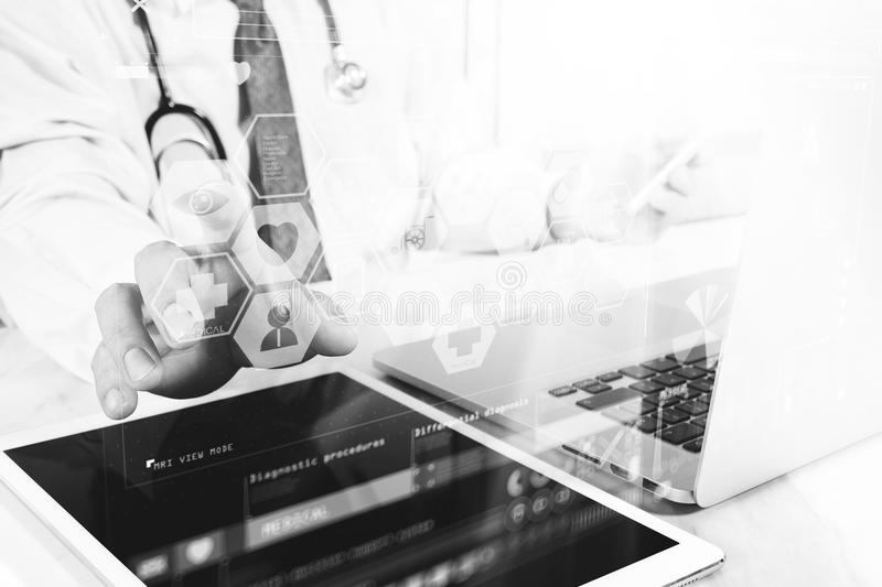 Medical technology concept. Doctor hand working with modern digital tablet and laptop computer with medical chart interface, Sun. Medical technology concept royalty free stock photos
