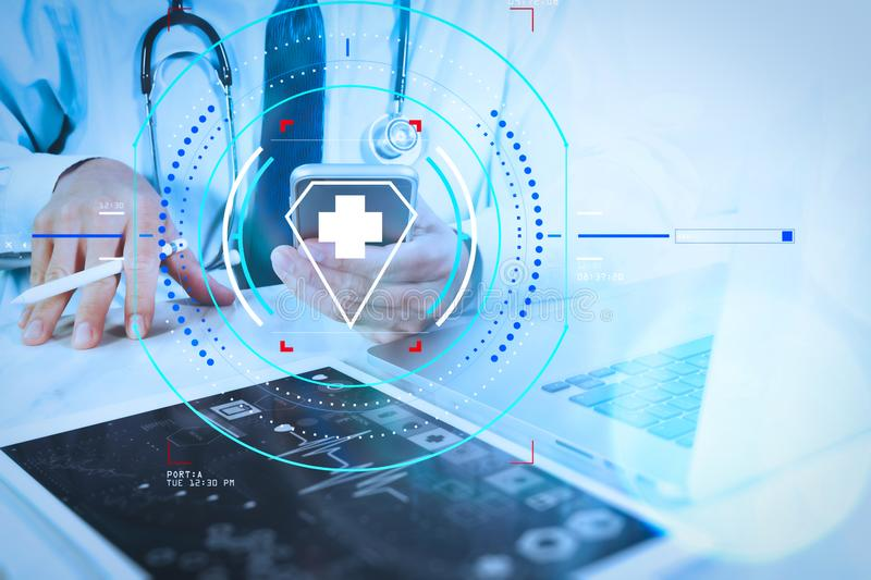 Medical technology concept. Doctor hand working with modern digital tablet and laptop computer with medical chart interface, Sun. Health care and medical stock photography