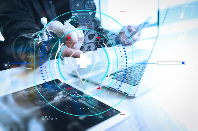 Medical technology concept. Doctor hand working with modern digital tablet and laptop computer with medical chart interface, Sun. Health care and medical royalty free stock photo