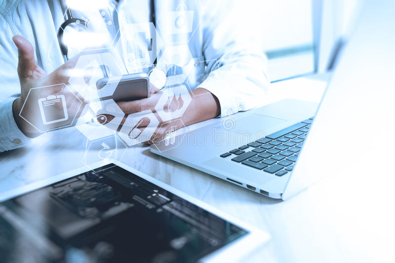 Medical technology concept. Doctor hand working with modern smart phone with medical chart interface,multi channel. Connection,network hospital concept royalty free stock photography