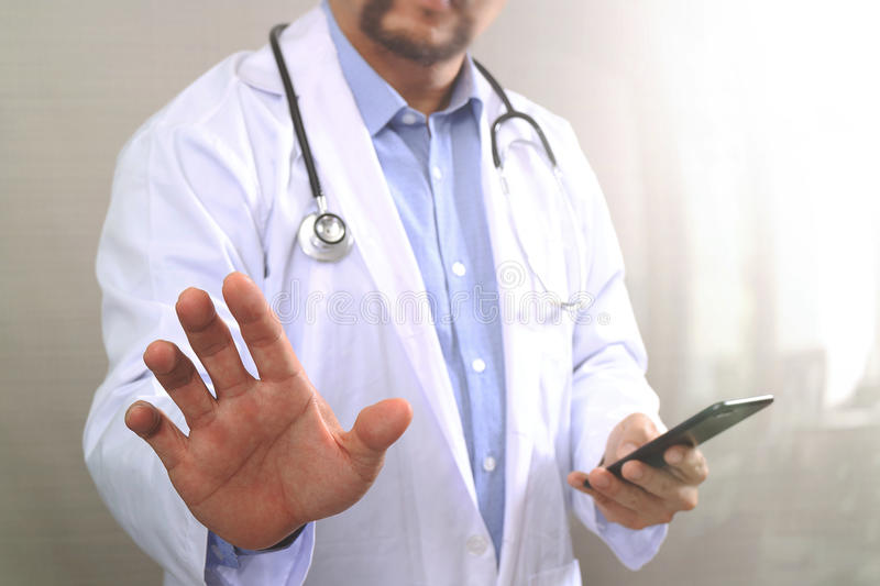 Medical technology concept. Doctor hand working with modern smart phone with medical chart interface,multi channel. Connection,white background royalty free stock photo
