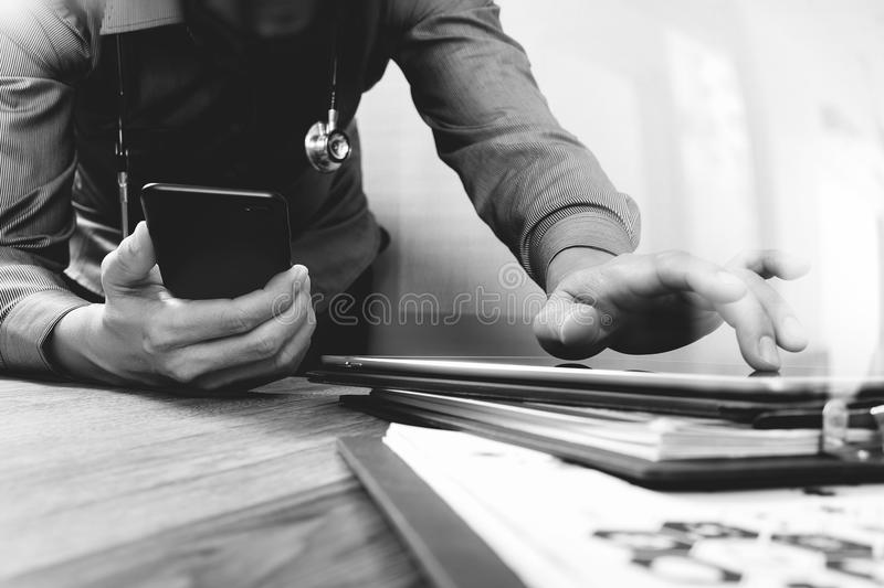 Medical technology concept. Doctor hand working with modern smart phone with medical chart interface,multi channel. Connection,white background,black white stock photo