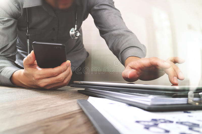 Medical technology concept. Doctor hand working with modern smart phone with medical chart interface,multi channel. Connection,white background royalty free stock image