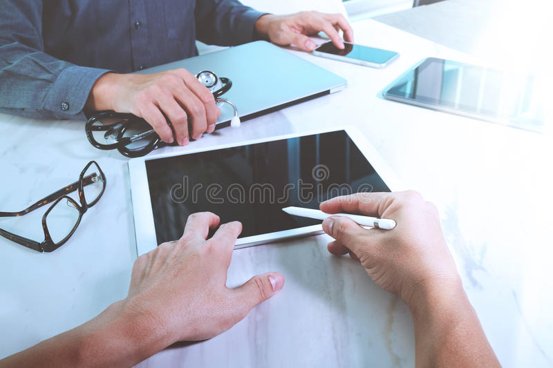 Medical technology network team meeting concept. Doctor hand working smart phone modern digital tablet laptop computer medical ch. Art interface, sun flare royalty free stock images