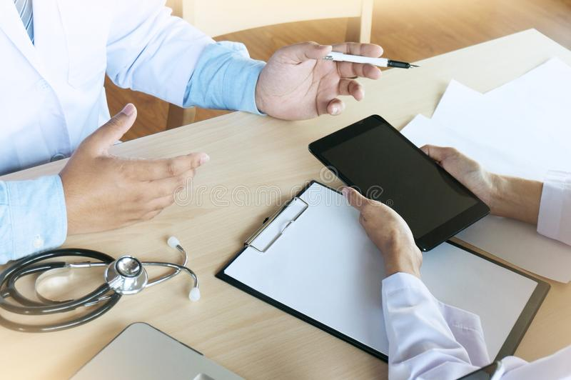 Medical technology network team meeting concept. Doctor hand working smart phone modern digital tablet laptop computer graphics c. Hart interface stock image