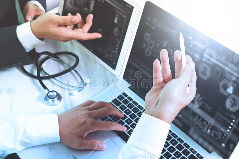 Medical technology network team meeting concept. Doctor hand working smart phone modern digital tablet laptop computer graphics c. Hart interface, sun flare royalty free stock images