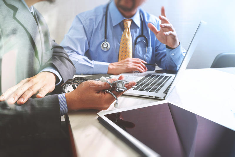 Medical technology network team meeting concept. Doctor hand working smart phone modern digital tablet laptop computer graphics c. Hart interface, sun flare royalty free stock photos