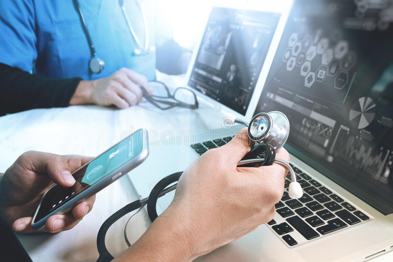 Medical technology network team meeting concept. Doctor hand working smart phone modern digital tablet laptop computer graphics c. Hart interface, sun flare stock images