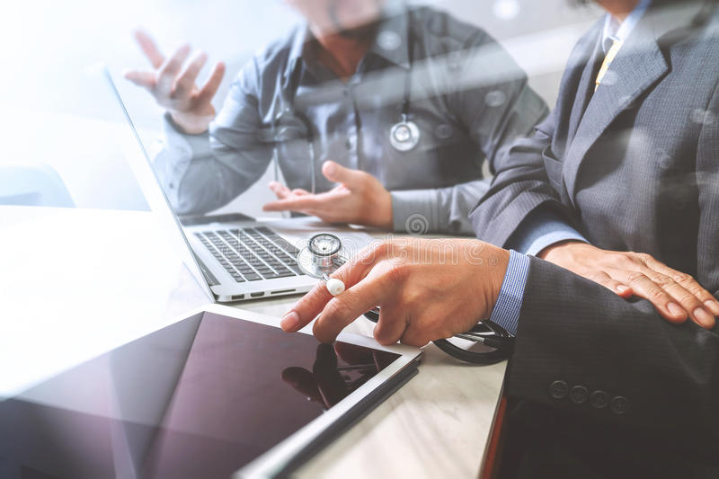 Medical technology network team meeting concept. Doctor hand working smart phone modern digital tablet laptop computer graphics c. Hart interface, sun flare stock photo