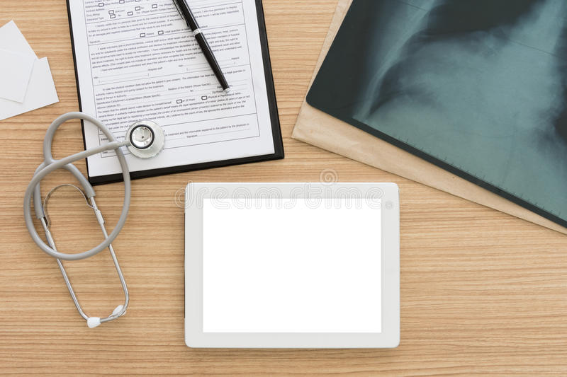 Medical and technology. Tablet computer empty screen, medical record application form with x-ray images on doctor`s desk. medical and technology concept. top royalty free stock photos