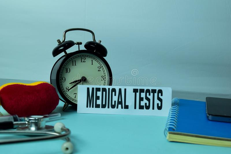 Medical Tests Planning on Background of Working Table with Office Supplies. Medical and Healthcare Concept Planning on White Background stock photography