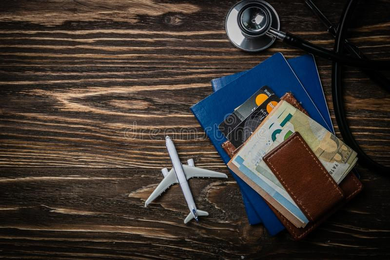 Medical tourism concept - passports, stethoscope, airplane, money royalty free stock photos