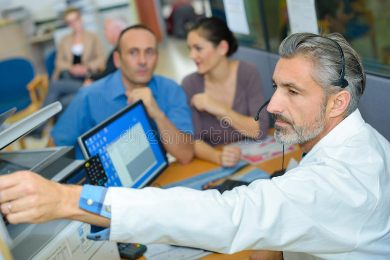 Medical transcriptionist preparing discharge royalty free stock image