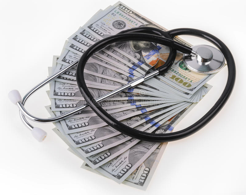 Medical treatment and cost concept: stethoscope placing on US dollars banknotes royalty free stock photography